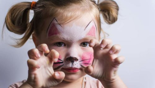Toddler-with-Face-Painted-Like-Cat